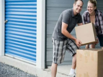 Couples putting boxes in storage - RS Removal Company - Removals and Storage Services